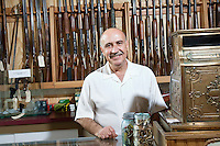 Portrait of a mature merchant in gun shop