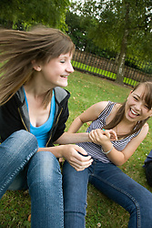 Portrait of teenage girls laughing in the park,