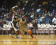 "Ole Miss guard Chris Warren (12) drives to the basket past Southern Mississippi guard R.L. Horton (15) at C.M. ""Tad"" Smith Coliseum in Oxford, Miss. on Saturday, December 4, 2010."
