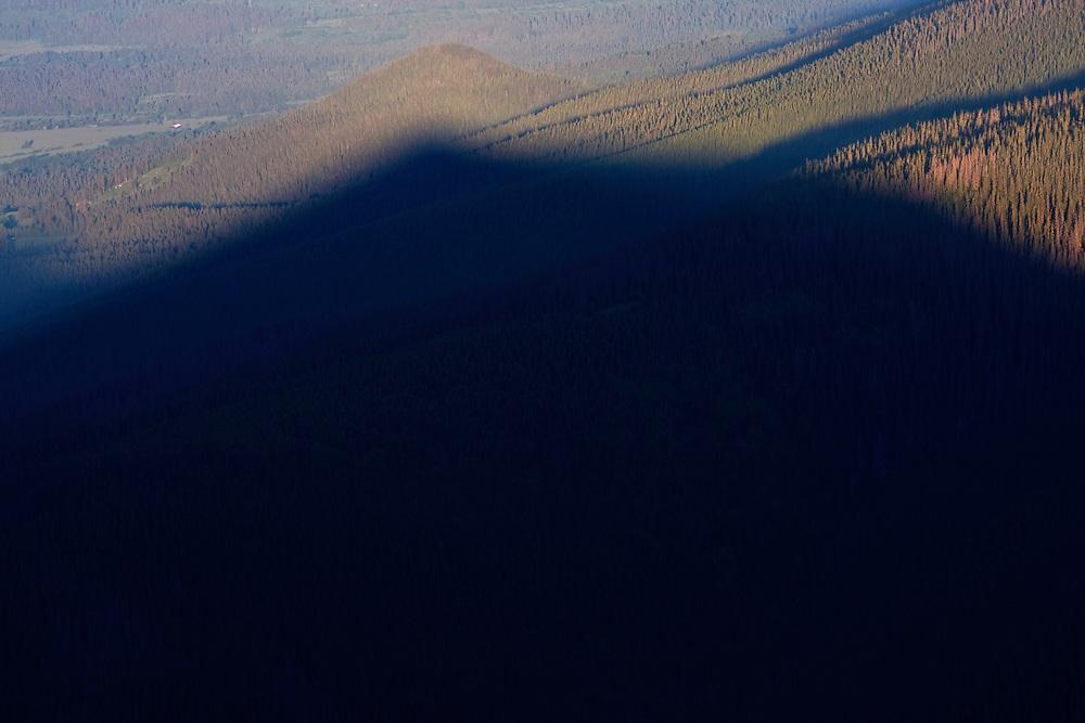 The shadow of Mount Krizna (2039 m asl) on the Suchy Hradok. Western Tatras, Slovakia. June 2009. Mission: Ticha