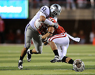 November 21, 2009: Linebacker Ulla Pomele #51 of the Kansas State Wildcats tackles running back Roy Helu Jr. #10 of the Nebraska Cornhuskers short of a first down in the fourth quarter at Memorial Stadium in Lincoln, Nebraska.