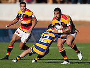 Liam Messam tackled by Phil Burleigh during the Air New Zealand Cup rugby match between Waikato and Bay of Plenty won by BOP 32-16 at Bay Park Stadium, Tauranga, New Zealand, Saturday 22 August 2009. Photo: Stephen Barker/PHOTOSPORT