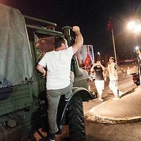 An AKP protesters on military van
