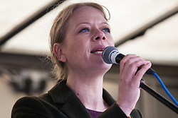 London, UK. 1st December, 2018. Sian Berry, Co-Leader of the Green Party, addresses the Together for Climate Justice demonstration against Government policies in relation to climate change, including Heathrow expansion and fracking. Following a rally outside the Polish embassy, chosen to highlight the UN's Katowice Climate Change Conference which begins tomorrow, protesters marched to Downing Street.