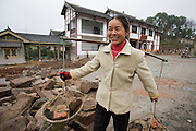 Woman at work building new tourist centre at Dazu Rock Carvings, Mount Baoding, Chongqing, China