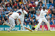 England & Yorkshire wicket keeper Jonny Bairstow  is in as Sri Lanka wicket keeper Dinesh Chandimal takes the stumps off during day 2 of the first Investec Test Series 2016 match between England and Sri Lanka at Headingley Stadium, Headingley, United Kingdom on 20 May 2016. Photo by Simon Davies.