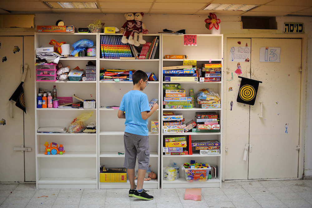 UNSPECIFIED, ISRAEL - JULY 17, 2014:An Israeli kid  playing in  abomb shelter in the Southern city of Sderot, on July 17, 2014. Photo by Gili Yaari.