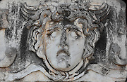 Giant Gorgon head, 2nd century AD, from the Temple of Apollo, 4th century BC, Didyma, Aydin, Turkey. The Gorgons were 3 sisters (Medusa, Stheno and Euryale) with snakes for hair, who could turn people to stone. They are patrons of secrecy, protecting the mystery of the oracle, and their faces were here used as a charm against illness. Didyma was an ancient Greek sanctuary on the coast of Ionia near Miletus, consisting of a temple complex and the oracle of Apollo, or Didymaion, who was visited by pilgrims from across the Greek world. The earliest temple ruins found here date to the 8th century BC but Didyma's heyday lasted throughout the Hellenistic age. It was approached along a 17km Sacred Way from Miletus and is the largest sanctuary in Western Turkey. Picture by Manuel Cohen