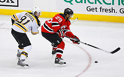 Dec 23, 2008; Newark, NJ, USA; New Jersey Devils defenseman Johnny Oduya (29) skates by Boston Bruins right wing Phil Kessel (81) during the second period at the Prudential Center.
