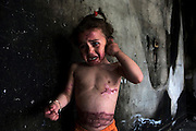"Palestinian three year-old Farah Abu Halima   in one of the many burnt rooms in the Abu Halima home in the a-Sifa section of Beith Layiha, Gaza April 23,2009. Farah's mother Ghada died of her wounds in an Egyptian hosptal on March 29,2009. Farah sustained severe burns and was evacuated to Egypt for emergency medical together with her mother when the Abu Halima home was shelled on January 4,2009 during the Israeli military invasion into the Gaza Strip code named ""Operation Cast Lead"" . Five of the Abu Halima family members were burned to death ..Fahar's mother gave her testimony to B'Tselem, the Israeli Information Center for Human Rights in the Occupied Territories. In her testimony she described how she was holding her daughter Farah when her whole body caught on fire .She described in her testimony that she had taken all of her clothes off and still her body continued to burn .(Photo by Heidi Levine/Sipa Press)...."