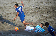 El Salvador's Elmer goes down following a challenge from Argentina midfielder Tarabini at the Copa Pilsener 2016.
