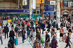 © Licensed to London News Pictures. 08/08/2016. London, UK. People travel at Victoria Station in London, as hundreds of thousands of rail passengers face a week of travel chaos because of a five-day strike in an escalating dispute over the role of conductors between Southern Rail and the RMT Union. Photo credit: Tolga Akmen/LNP