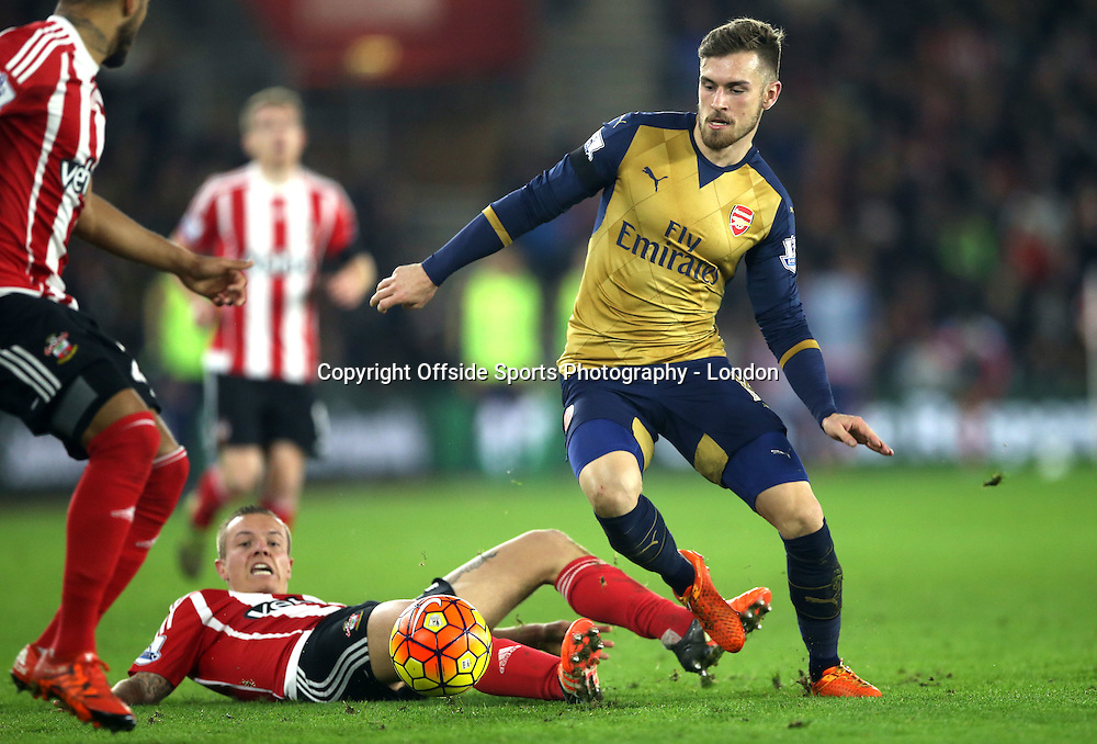 26 Devember 2015 - Premier League Football - Southampton v Arsenal :<br /> Aaaron Ramsey of Arsenal is tackled by Jordy Clasie of Southampton.<br /> Photo: Mark Leech