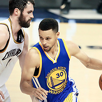 10 June 2016: Cleveland Cavaliers forward Kevin Love (0) defends on Golden State Warriors guard Stephen Curry (30) during the Golden State Warriors 108-97 victory over the Cleveland Cavaliers, during Game Four of the 2016 NBA Finals at the Quicken Loans Arena, Cleveland, Ohio, USA.