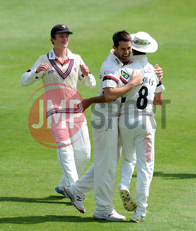 Somerset's Tim Groenewald celebrates with Somerset's Alfonso Thomas after dismissing Nottinghamshire's Riki Wessels. - Photo mandatory by-line: Harry Trump/JMP - Mobile: 07966 386802 - 15/06/15 - SPORT - CRICKET - LVCC County Championship - Division One - Day Two - Somerset v Nottinghamshire - The County Ground, Taunton, England.
