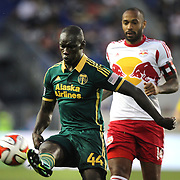 Pa Modou Kah, (left), Portland Timbers, is challenged by Thierry Henry, New York Red Bulls, during the New York Red Bulls Vs Portland Timbers, Major League Soccer regular season match at Red Bull Arena, Harrison, New Jersey. USA. 24th May 2014. Photo Tim Clayton