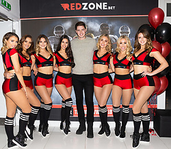 Love Island's Dr Alex is welcomed by cheerleaders to the RedZone.Bet thanksgiving party at Millbank Tower in London. London, November 22 2018.
