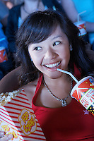 Woman Drinking Soda While Watching Movie
