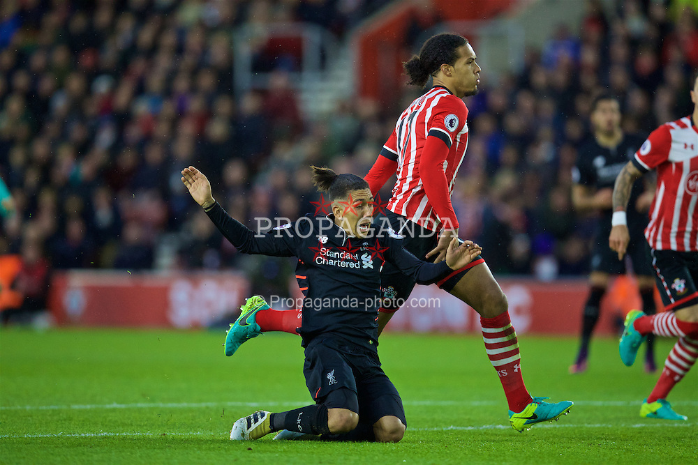 SOUTHAMPTON, ENGLAND - Saturday, November 19, 2016: Liverpool's Roberto Firmino is brought down by Southampton's Virgil Van Dijk but no penalty was awarded during the FA Premier League match at St. Mary's Stadium. (Pic by David Rawcliffe/Propaganda)