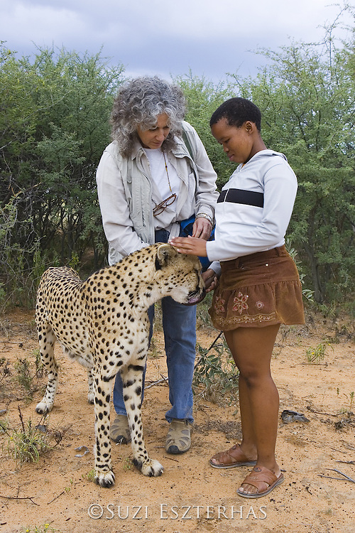 Dr. Laurie Marker and Namibian school children meeting Chewbacca (an adult male cheetah that was orphaned as a small cub and raised by Dr. Marker) during an education program<br /> Cheetah Conservation Fund, Namibia<br /> *Captive