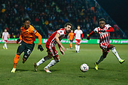 Barnet midfielder Ephron Mason-Clark (27), Brentford defender Yoann Barbet (29) and Brentford defender Moses Odubajo (2) battle for possession during The FA Cup fourth round match between Barnet and Brentford at The Hive Stadium, London, England on 28 January 2019.