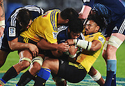 Ma'a Nonu raps up Akira Ioane during the Super Rugby match between The Blues and Hurricanes at Eden Park in Auckland, New Zealand. Saturday 23 May 2015. Copyright Photo: Andrew Cornaga / www.Photosport.co.nz