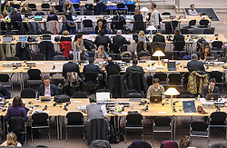 On the first day of the EU Summit, journalists work in the atrium of the European Council headquarters building, which serves as the main press room during summits, on Thursday, Dec. 13, 2012, in Brussels, Belgium. (Photo © Jock Fistick)