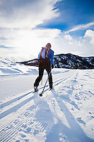 A woman cross country skiing on the Trails near Sun Mountain Lodge in the Methow valley, Washington, USA.
