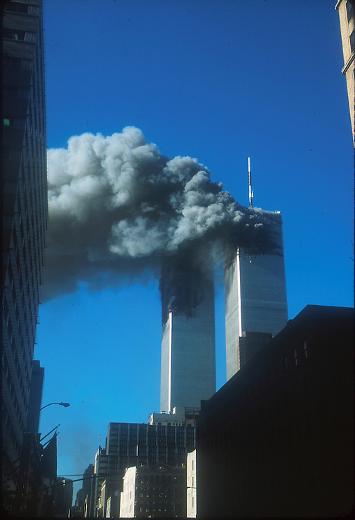 The Twin Towers burn after jet planes were flown into them in a terrorist attack on the World Trade Center, New York City, September 11, 2001. Photo by Lisa Quinones.