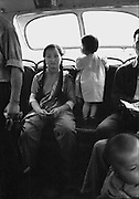 C002-22 Tom Hutchins_woman and child on bus, Canton (Guangzhou) 1956.tif