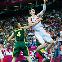08 August 2012: Russia Timofey Mozgov goes for the layup past Rimantas Kaukenas during 83-74 Team Russia victory over Team Lithuania, during the men's basketball quarter-finals, at the 02 Arena, in London, Great Britain.