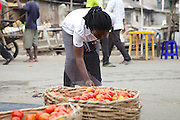 Joy buying some fresh tomatoes from the market.<br />
