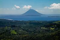 Indonesia, Sulawesi, Bunaken. Bunaken and Manado Tua seen from airplane, close to Manado's airport.