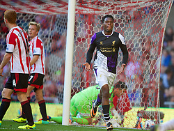 SUNDERLAND, ENGLAND - Sunday, September 29, 2013: Liverpool's Daniel Sturridge celebrates scoring the first goal against Sunderland during the Premiership match at the Stadium of Light. (Pic by David Rawcliffe/Propaganda)