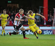 Brentford defender Jake Bidwell battling for the ball with Nottingham Forest striker Jamie Ward  during the Sky Bet Championship match between Brentford and Nottingham Forest at Griffin Park, London, England on 21 November 2015. Photo by Matthew Redman.