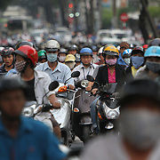 Thousands of motorcycles crowd the streets of Ho Chi Minh City also known as Saigon, the largest city in Vietnam. Inches apart, the motorbikes line up at traffic lights waiting for their turn to stream down avenues, weaving and racing their way across town. Some riders prefer using the sidewalks as they approach an intersection.<br /> Photography by Jose More