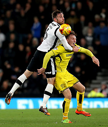 Richard Keogh of Derby County challenges Cauley Woodrow of Burton Albion to a header - Mandatory by-line: Robbie Stephenson/JMP - 21/02/2017 - FOOTBALL - iPro Stadium - Derby, England - Derby County v Burton Albion - Sky Bet Championship