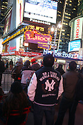 November 4, 2009 New York, New York:- Yankees win The 27th World Series and fans celebrate in kind thoughout Times Square Area with a few Phillies Fan just passing through on Novemeber 4, 2009 in New York City. Photo Credit: Terrence Jennings/Sipa