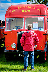 The 44th Biggar Vintage Vehicle Rally held in Biggar on 13th August 2017.  An enthusiast admiring a vintage vehicle.<br /> <br /> (c) Andrew Wilson | Edinburgh Elite media