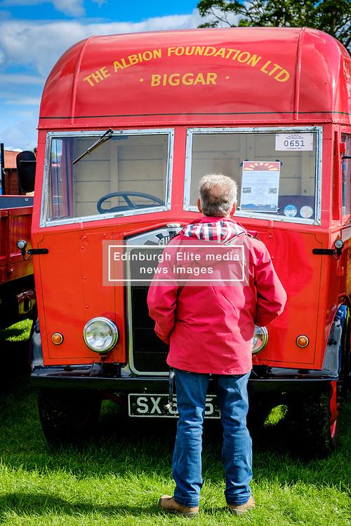 The 44th Biggar Vintage Vehicle Rally held in Biggar on 13th August 2017.  An enthusiast admiring a vintage vehicle.<br /> <br /> (c) Andrew Wilson | Edinburgh Elite media