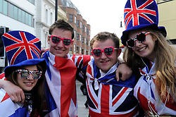 Brighton, UK. 29/04/2011. The Royal Wedding of HRH Prince William to Kate Middleton. People dressed in Union Flags celeberate outside Brighton Station. Photo credit should read: Peter Webb/LNP. Please see special instructions for licensing information. © under license to London News Pictures