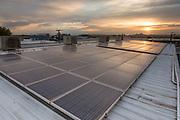 sunrise on solar panels of industrial building