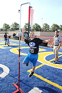 Matthew Statzer, 10, of Miamisburg practices the vertical jump during the All Pro Dad Father & Kids NFL Experience at Welcome Stadium, Saturday, June 18, 2016.