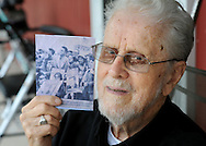NEWTOWN, PA -  OCTOBER 19:  Weldon Storey, 92, poses with a clipping from a 1960 newspaper showing him and his daughter at a Kennedy campaign event October 19, 2013 in Newtown, Pennsylvania. (Photo by William Thomas Cain/Cain Images)