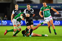George North of Ospreys breaks the tackle of Marco Zanon of Benetton Treviso<br /> <br /> Photographer Craig Thomas/Replay Images<br /> <br /> Guinness PRO14 Round 4 - Ospreys v Benetton Treviso - Saturday 22nd September 2018 - Liberty Stadium - Swansea<br /> <br /> World Copyright © Replay Images . All rights reserved. info@replayimages.co.uk - http://replayimages.co.uk