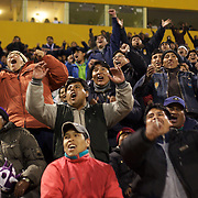 'Attitude at Altitude' Football in Potosi, Bolivia'..Real Potosi fans celebrate a goal for the home side during a night match between Real Potosi and Universitario Sucre at the Estadio Victor Agustin Ugarte, home of Bolivian football team Real Potosi. Real Potosi won the match 4-3. Potosi, Bolivia, 12th May 2010. Photo Tim Clayton...'Attitude at Altitude' Football in Potosi, Bolivia'..The Calvario players greet the final whistle with joyous celebration, high fives and bear hugs the players are sprayed with local Potosina beer after a monumental 3-1 victory over arch rivals Galpes S.C. in the Liga Deportiva San Cristobal. The Cup Final, high in the hills over Potosi. Bolivia, is a scene familiar to many small local football leagues around the world, only this time the game isn't played on grass but a rock hard earth pitch amongst gravel and boulders and white lines that are as straight as a witches nose, The hard surface resembles the earth from Cerro Rico the huge mountain that overlooks the town. .. Sitting at 4,090M (13,420 Feet) above sea level the small mining community of Potosi, Bolivia is one of the highest cities in the world by elevation and sits 'sky high' in the hills of the land locked nation. ..Overlooking the city is the infamous mountain, Cerro Rico (rich mountain), a mountain conceived to be made of silver ore. It was the major supplier of silver for the spanish empire and has been mined since 1546, according to records 45,000 tons of pure silver were mined from Cerro Rico between 1556 and 1783, 9000 tons of which went to the Spanish Monarchy. The mountain produced fabulous wealth and became one of the largest and wealthiest cities in Latin America. The Extraordinary riches of Potosi were featured in Maguel de Cervantes famous novel 'Don Quixote'. One theory holds that the mint mark of Potosi, the letters PTSI superimposed on one another is the origin of the dollar sign...Today mainly zinc, lead, tin and small quantities of silver are extracted from