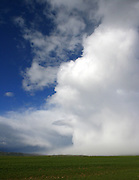 I watched this fast moving storm send waves of clouds and rain across Jackson hole in late May 2011. I was impressed with the shear size of this wall as it rose from the grasslands of the Elk refuge