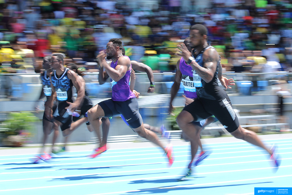 Tyson Gay, (center), USA, winning the Men's 100m Competition during the Diamond League Adidas Grand Prix at Icahn Stadium, Randall's Island, Manhattan, New York, USA. 13th June 2015. Photo Tim Clayton