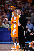 ST. LOUIS, MO - MARCH 26: Head coach Bruce Pearl of the Tennessee Volunteers talks to guard Scotty Hopson #32 at a break in the game against the Ohio State Buckeyes during the Midwest regional semi-final of the NCAA men's basketball tournament at the Edward Jones Dome on March 26, 2010 in St. Louis, Missouri. Tennessee advanced with a 76-73 win. (Photo by Joe Robbins)