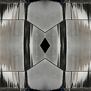 Water stains creating abstract on weathered facade of metal sculpture. <br /> <br /> Two or more layers were used to enhance, alter, manipulate the image, creating an abstract surrealistic mirrored symmetry.